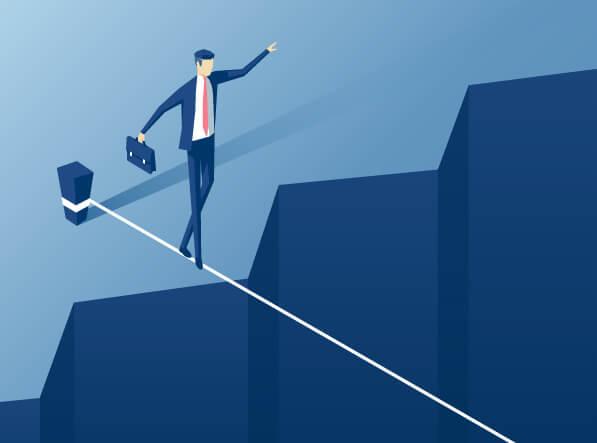 man walking tightrope
